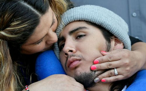 One of the victims of the Ethan Couch drink driving incident, Sergio Molina, right, is hugged by his mother Maria Lemus at a court hearing in 2016. (AP).