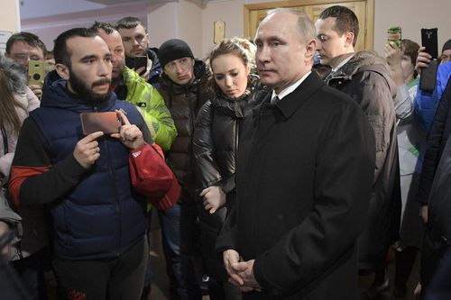 Vladimir Putin visiting victims of the horror supermarket blaze which killed at least 64 people in the Siberian city of Kemerovo. Picture: AAP