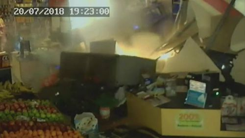 The car ploughed through a wall sending the checkout and cigarette cabinet flying. Picture: Supplied