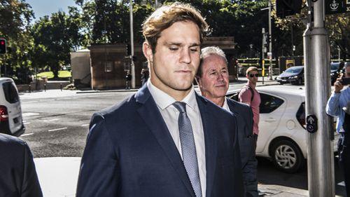 Jack de Belin arrives at Downing Centre Local & District Court in Sydney.
