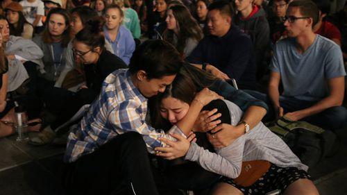 Students at a vigil at the University of Nevada. (AAP)