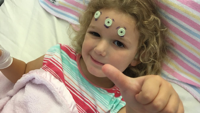 Emily thumbs up from hospital