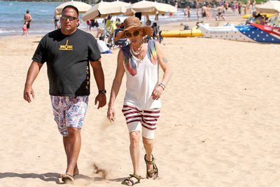 Steven Tyler slaps on a wide-brimmed hat in Miami.