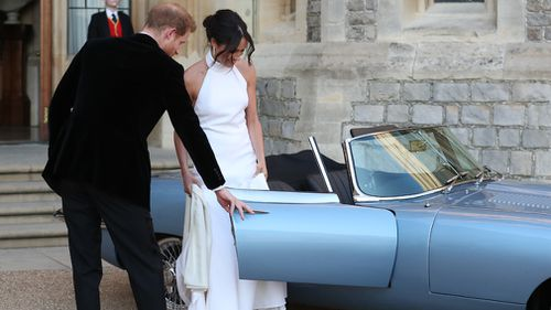 The first time the dress was revealed was as the newlyweds hopped into a vintage Jag to go to their evening reception at Frogmore House. Picture: Getty