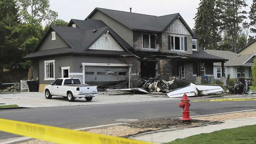 Youd's wife and a child were in the house at the time, but escaped the fireball. Picture: AP