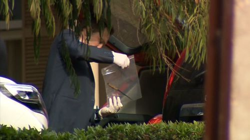 Police have removed a knife from the boot of a car at the Walsh residence, but it is unknown if it was used in the alleged murder. (9NEWS)