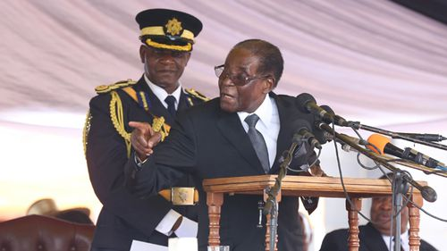 Zimbabwe President Robert Mugabe delivers a speech during the burial of liberation war hero Don Muvuti at the national heroes acre in Harare, Zimbabwe on 1 November, 2017. (AAP)
