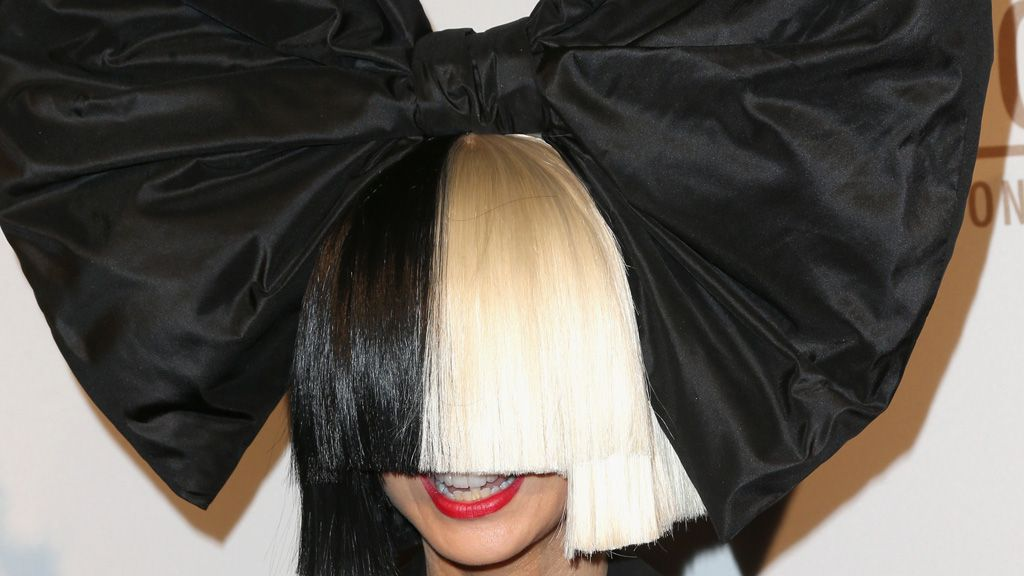 Faceless Sia signs with makeup label