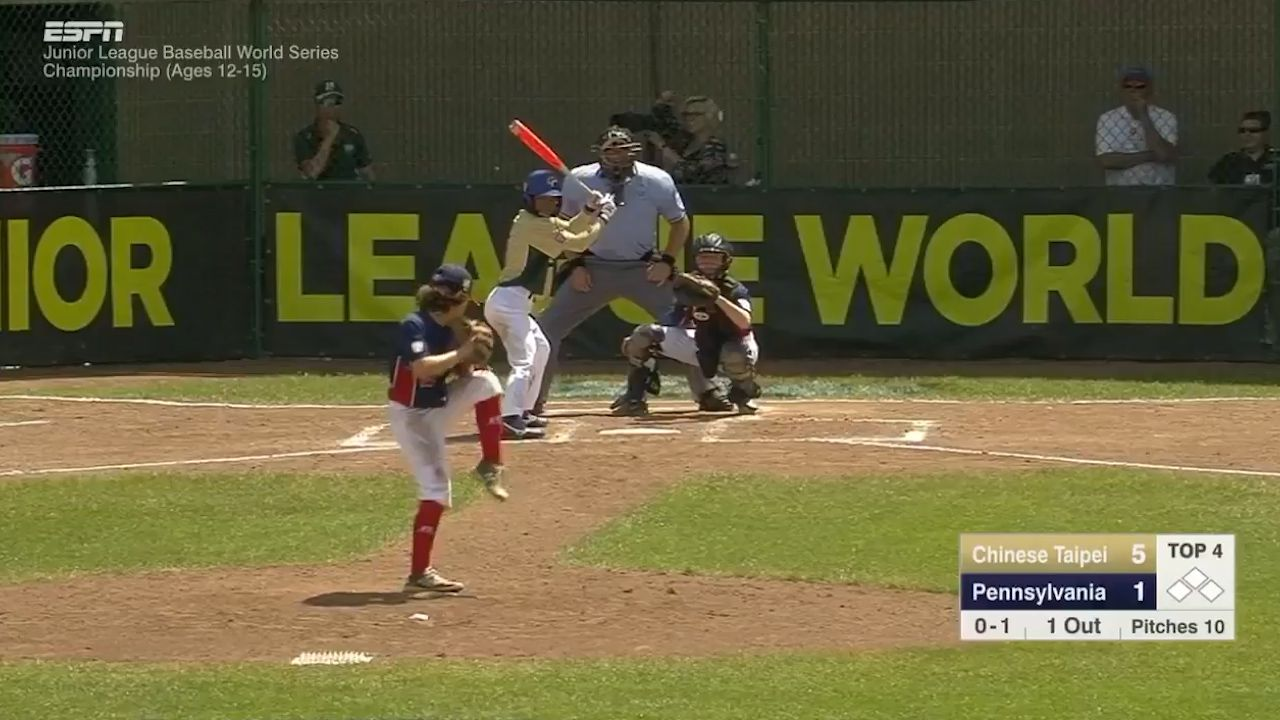 Baseball kid gets airborne for epic catch