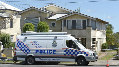 A police car pictured outside the Greenslope's home where Ms Miller was found dead.