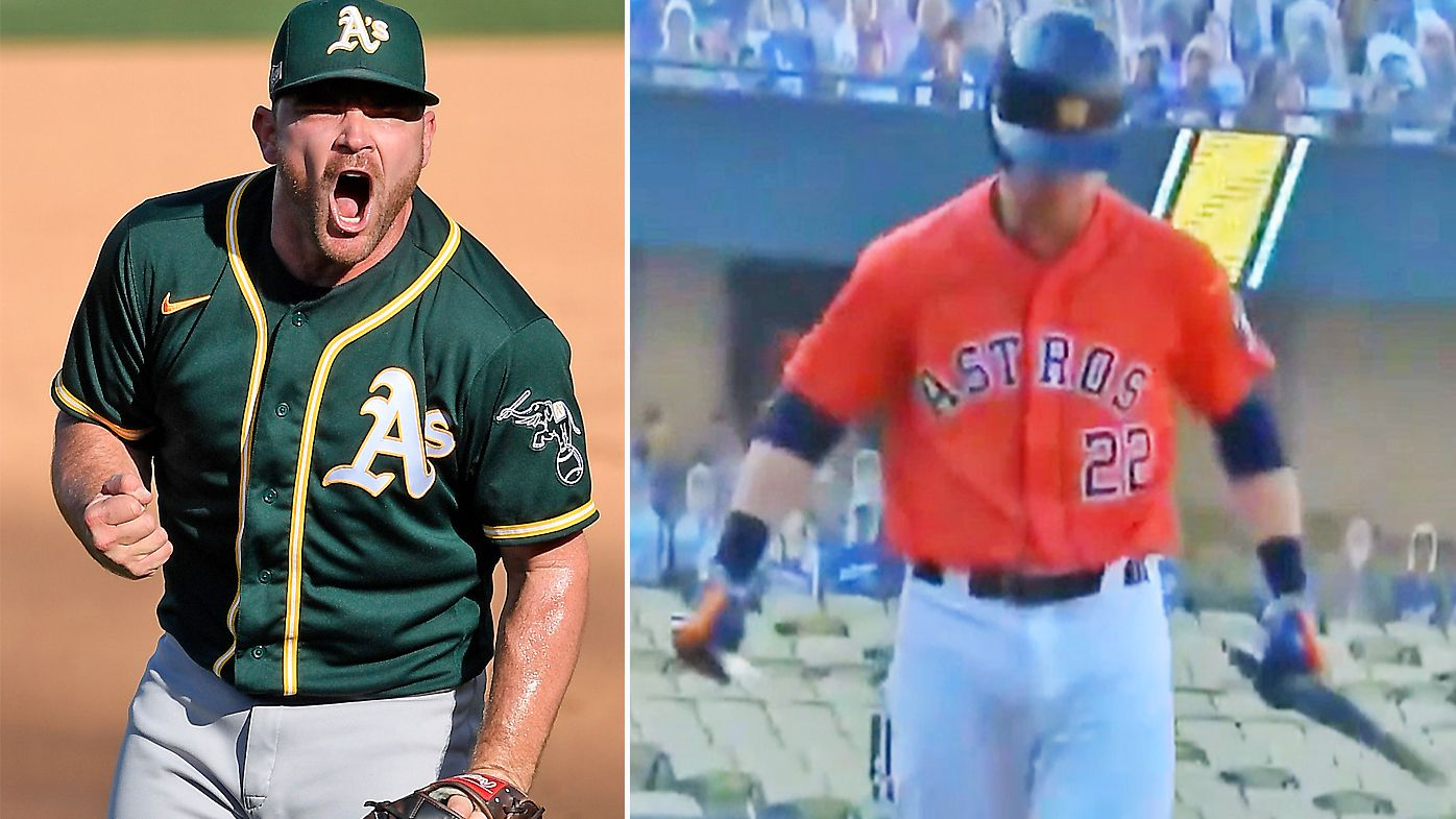Houston Astros' Josh Reddick breaks his bat over his knee after striking out against the Oakland Athletics' Liam Hendriks