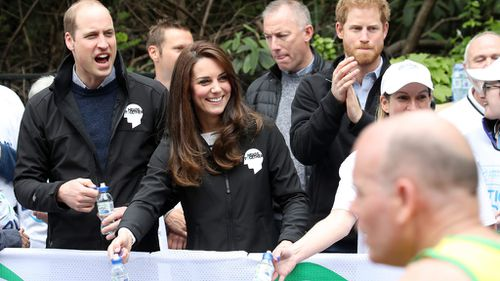 The Duke and Duchess of Cambridge and Prince Harry cheered on runners in the London Marathon. (AFP)