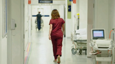 A nurse walks the halls of Royal Melbourne Hospital in Emergency.