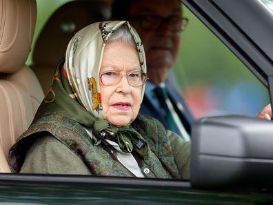 Queen Elizabeth driving a car.