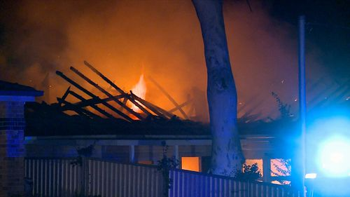 Neighbouring houses had to be evacuated when strong winds fanned the blaze. Image: 9News