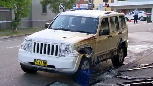 A car outside the store was also damaged. (9NEWS)