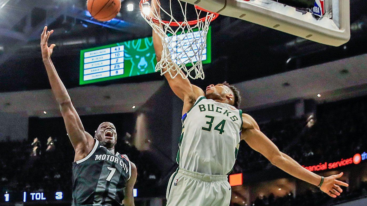 Bucks forward Giannis Antetokounmpo blocks a shot by Detroit Pistons forward Thon Maker
