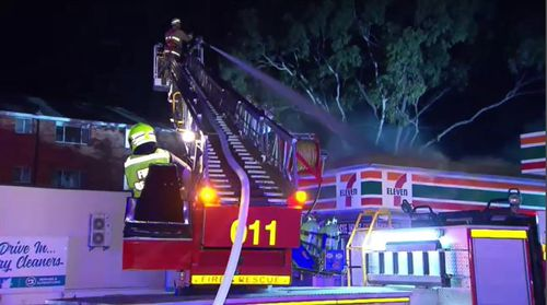 Both businesses suffered significant structural damage and nearby units and a hospital were spared from any danger. Picture: 9NEWS.