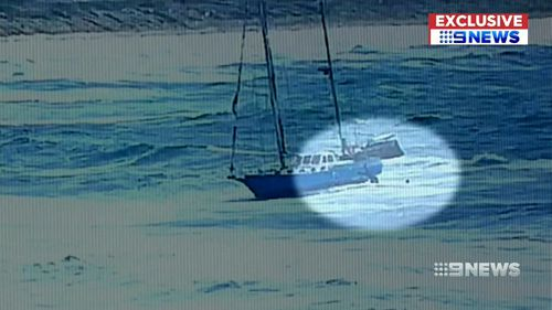 Video shows the men leaping for their lives as the yacht is battered by a two-metre swell.