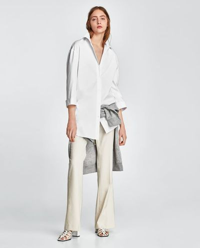 "<a href=""https://www.zara.com/au/en/poplin-shirt-p07099873.html?v1=5655574&v2=1010039"" target=""_blank"">Zara Poplin Shirt in White, $99</a>"
