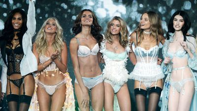 Models show off the latest lingerie looks at the Victoria's Secret Fashion Show in London. (AAP)