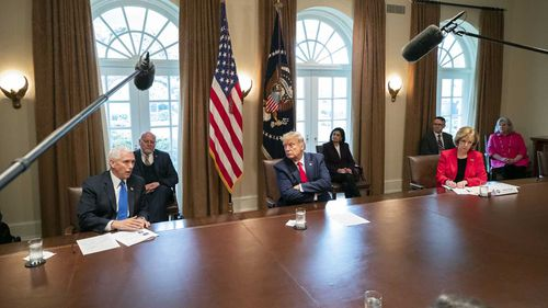 Donald Trump has described himself as a 'wartime president', barely a fortnight after dismissing the likelihood of a coronavirus outbreak in the United States.