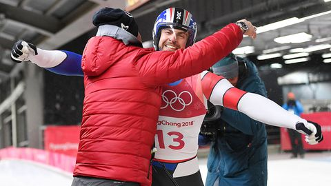 Chris Mazdzer of the US reacts at the finish line