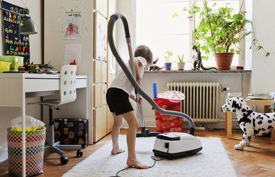 Boy vacuuming