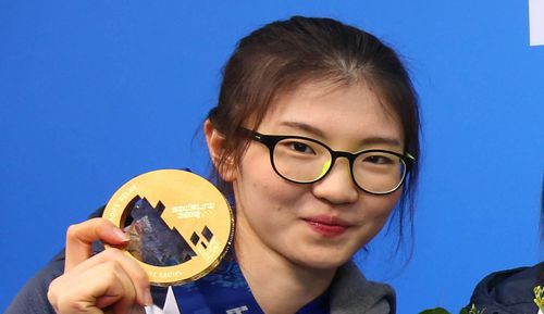 South Korean short track skater Shim Suk-hee with her Olympic gold medal from the women's 3,000m relay in Sochi, Russia.