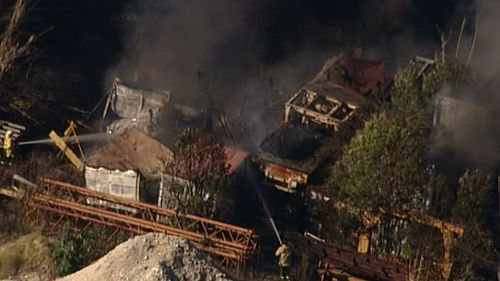 A blaze consumes an industrial state near Penrith, in Sydney's West. (9NEWS)
