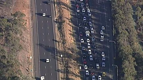 There were queues of up to 11km this morning when the truck crashed into the overpass at Colyton on the M4. Picture: 9NEWS