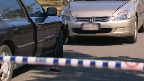 The woman's car was allegedly rammed before she was chased with a machete. (9NEWS)