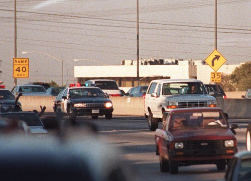 Police cars pursue the white Ford Bronco driven by Al Cowlings, carrying O.J. Simpson on June 17, 1994 on the 405 freeway in Los Angeles.