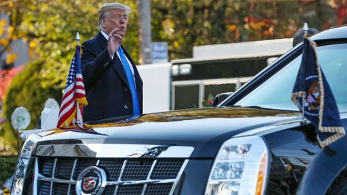 President Donald Trump waves and makes a short statement to the media present at the Tree of Life Synagogue in Pittsburgh.