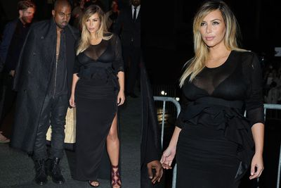 Swapping the curve-covering coats for cleavage-bearing LBD's, Kim and Kanye hit the Givenchy Paris Fashion Week show wearing....well, Givenchy of course. <br/><br/>Source: Getty