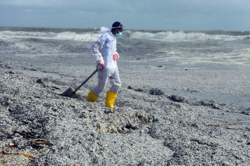 Police warned people not to touch the pollution, which swamped beaches.