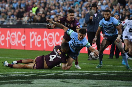 Latrell Mitchell uses his strength to go over for a try. Picture: AAP