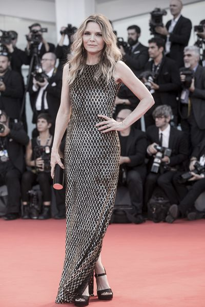 Michelle Pfeiffer in Michael Kors, Tods clutch and Salvatore Ferragamo shoes at the Venice Film Festival, 2017.
