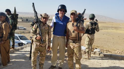 Peter Stefanovic pictured with Peshmerga soldiers on the outskirts of Mosul. (9NEWS)