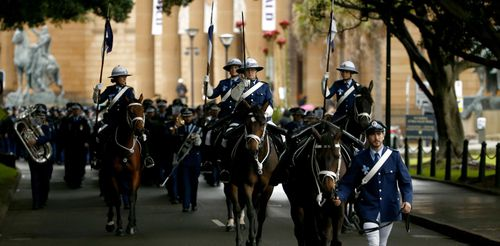 NSW Police officers march towards the NSW Police Wall of Remembrance on September 29, 2016 in Sydney.