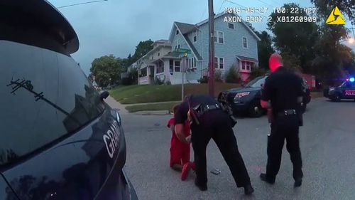 A US police department is investigating after officers handcuffed 11-year-old twins and a 17-year-old family friend at gunpoint.