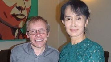 Sean Turnell and Aung San Suu Kyi in his LinkedIn bio photo