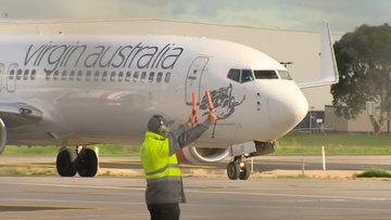 A passenger on board a Virgin Australia flight has tested positive to COVID-19 after arriving in Adelaide.