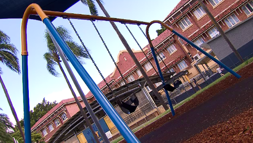A boy still in nappies has suffered horrific burns after one of his parents allegedly placed him on a hot stove.