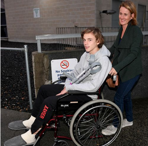Sam Kanizay on a wheelchair pushed by his mother Jane, from the Dandenong Hospital. (AAP)