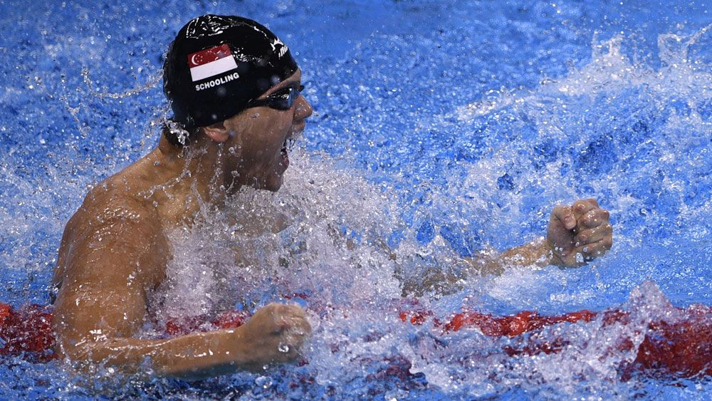 Joseph Schooling celebrates his 100m butterfly final. (AFP)