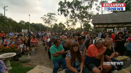 Hundreds of locals turned out to protest against the move. (9NEWS)