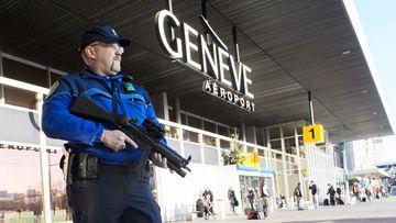 An armed policeman patrols on December 12, 2015 at Geneva Airport in Geneva. (AFP)