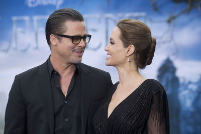 """Angelina Jolie and Brad Pitt don't make red carpet appearances together very often. So when they walked along hand-in-hand for a special <i>Maleficent</i> event at London's Kensington Palace, they took the opportunity to show off some epic public displays of affection. Aww, you guys!<br/><br/>Check out all the candid snaps from the event in our slideshow...<br/><br/>(<i>Written by <b><a target=""""_blank"""" href=""""https://twitter.com/yazberries"""">Yasmin Vought</a></b>. Approved by Amy Nelmes</i>)"""