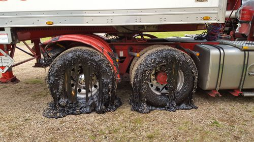 A close-up of the truck's tyre's covered in tar (Picture: Deborah Stacey)